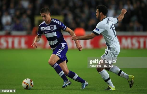 Anderlecht's Leander Dendoncker holds off challenge from Tottenham Hotspur's Mousa Dembele