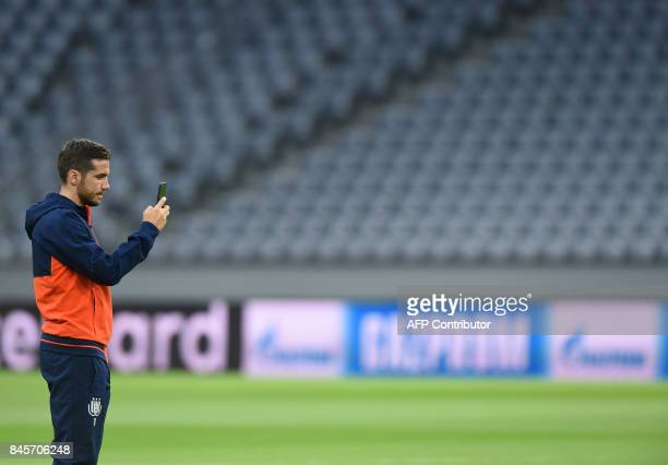 Anderlecht's midfielder Alexandru Chipciu takes a picture during a first visit prior the team training session ahead the first Champions League group...