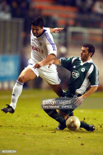 Anderlecht's Nenad Jestrovic is tackled by Panathinaikos's Ioannis Goumas