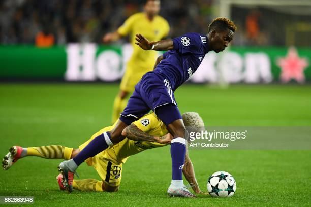 Anderlecht's Nigerian forward Henry Onyekuru vies with Paris SaintGermain's Brazilian defender Dani Alves during the UEFA Champions League Group B...