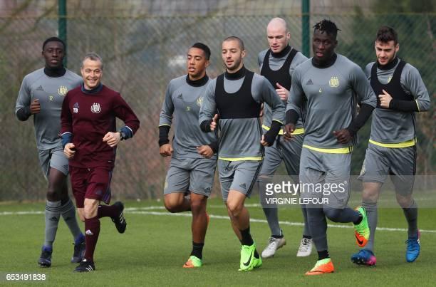 Anderlecht's players Dennis Appiah physical trainer Thomas Binggeli Youri Tielemans Sofiane Hanni Bram Nuytinck Kara Mbodji and Massimo Bruno run...