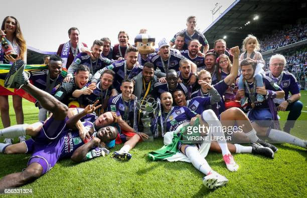 TOPSHOT Anderlecht's players pose with the trophy as they celebrate winning their 34th Belgian championship title after the Jupiler Pro League match...