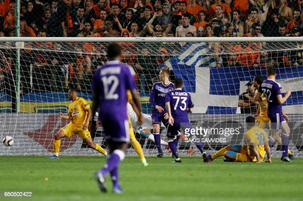 Anderlecht's Romanian midfielder Nicolae Stanciu shoots to score his team's opening goal during the Europa League round of 16 football match between...