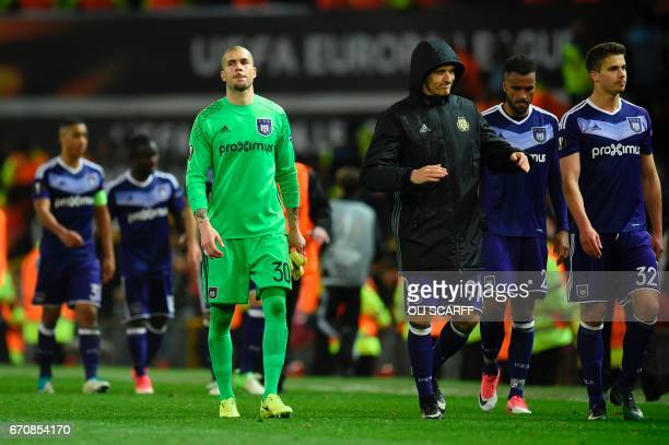 Anderlecht's Spanish goalkeeper Ruben Martinez Andrade walks off with team mate Youri Tielemans Isaac Kiese Thelin and Leander Dendoncker at full...