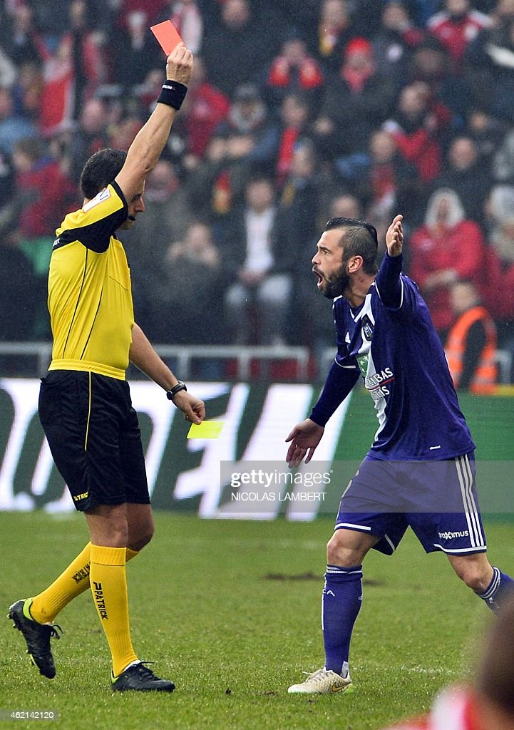 Anderlecht's <a gi-track='captionPersonalityLinkClicked' href=/galleries/search?phrase=Steven+Defour&family=editorial&specificpeople=5733692 ng-click='$event.stopPropagation()'>Steven Defour</a> reacts as he receives a red (for two yellow cards) card from the referee Alexandre Boucaut at the Jupiler Pro League match between Standard de Liege and RSC Anderlecht, in Liege, January 25, 2015, on day 23 of the Belgian soccer championship.