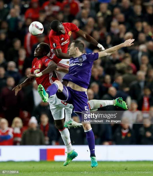 RSC Anderlecht's Uros Spajic battles for the ball with Manchester United's Paul Pogba and Manchester United's Eric Bailly