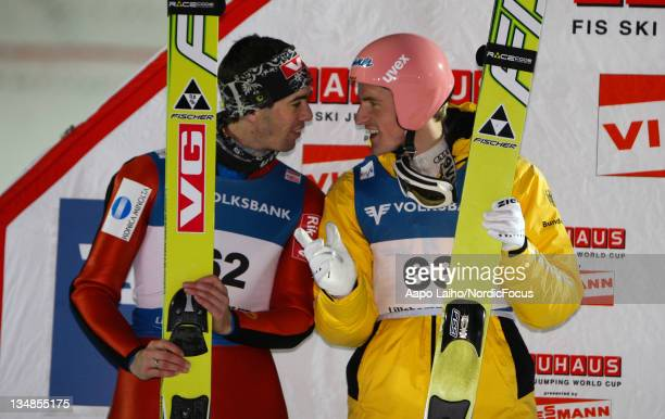 Anders Bardal of Norway and Severin Freund of Germany talk on the podium after the competition where both got the same amount of points and divided...