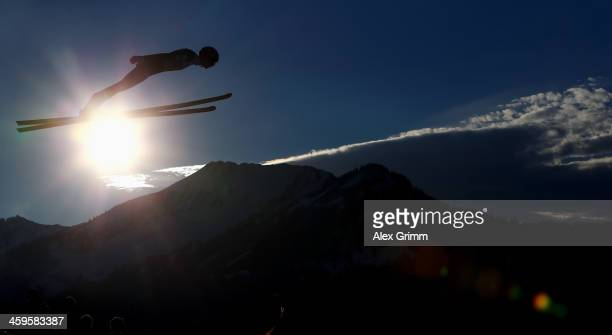 Anders Bardal of Norway soars through the air during the training round on day 1 of the Four Hills Tournament Ski Jumping event at...