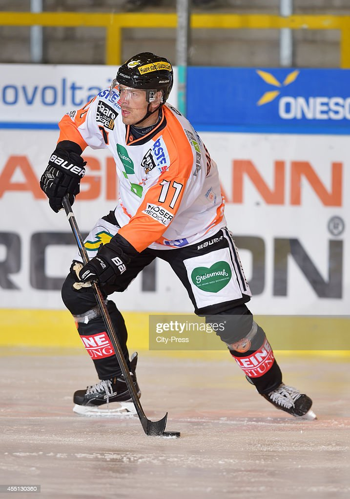 <a gi-track='captionPersonalityLinkClicked' href=/galleries/search?phrase=Anders+Bastiansen&family=editorial&specificpeople=2487581 ng-click='$event.stopPropagation()'>Anders Bastiansen</a> of Graz 99ers handles the puck during the action shot on august 17, 2014 in Landshut, Germany.