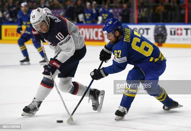 US Anders Bjork and Sweden´s Linus Omark vie during the IIHF Ice Hockey World Championships first round match between USA and Sweden in Cologne...