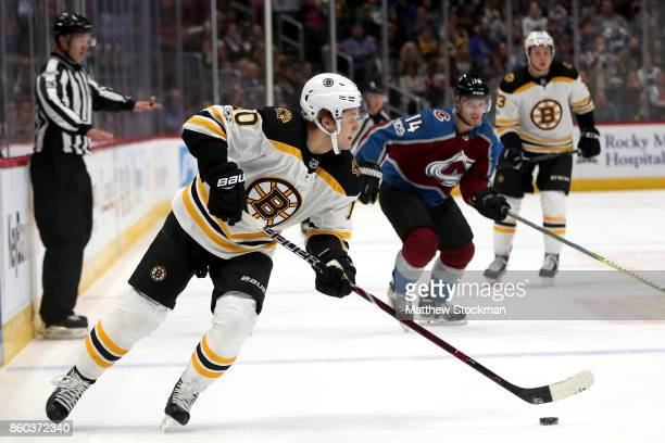 Anders Bjork of the Boston Bruins advances the puck against the Colorado Avalanche at the Pepsi Center on October 11 2017 in Denver Colorado