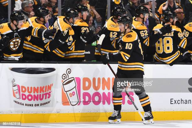 Anders Bjork of the Boston Bruins celebrates his first period goal against the Vancouver Canucks at the TD Garden on October 19 2017 in Boston...
