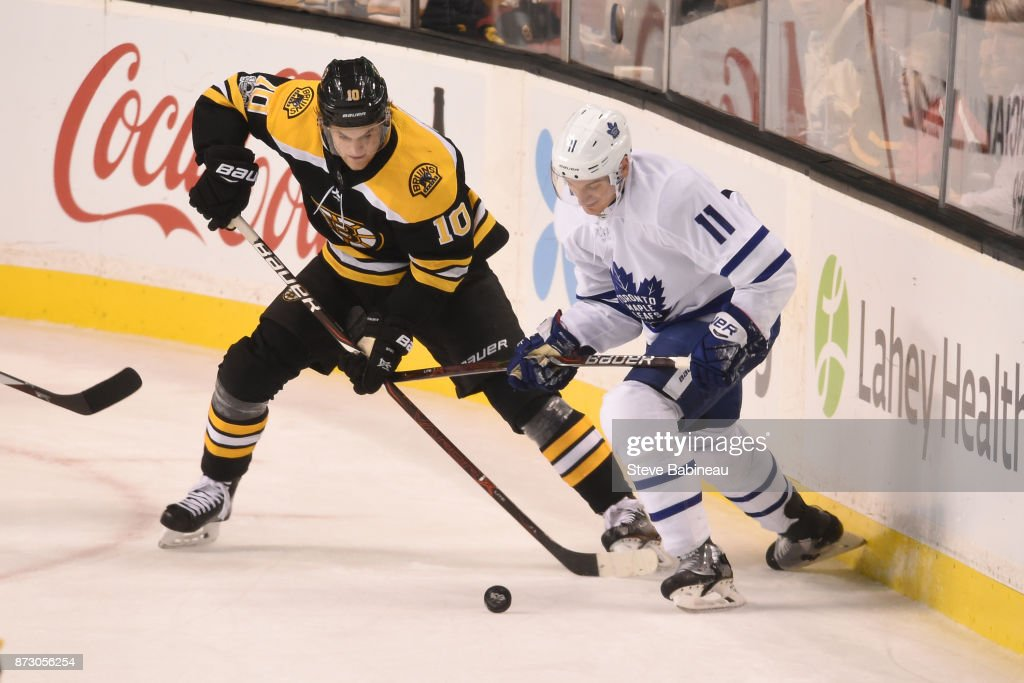 Anders Bjork #10 of the Boston Bruins fights for the puck against Zach Hyman #11 of the Toronto Maple Leafs at the TD Garden on November 11, 2017 in Boston, Massachusetts.