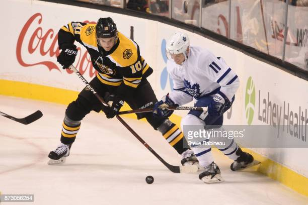 Anders Bjork of the Boston Bruins fights for the puck against Zach Hyman of the Toronto Maple Leafs at the TD Garden on November 11 2017 in Boston...