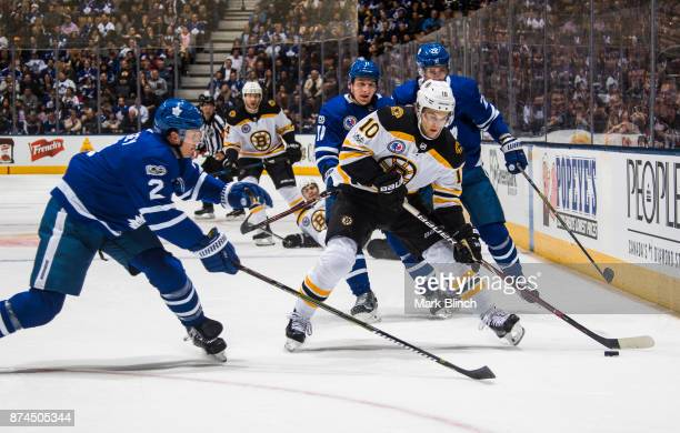Anders Bjork of the Boston Bruins skates against Ron Hainsey of the Toronto Maple Leafs during the second period at the Air Canada Centre on November...