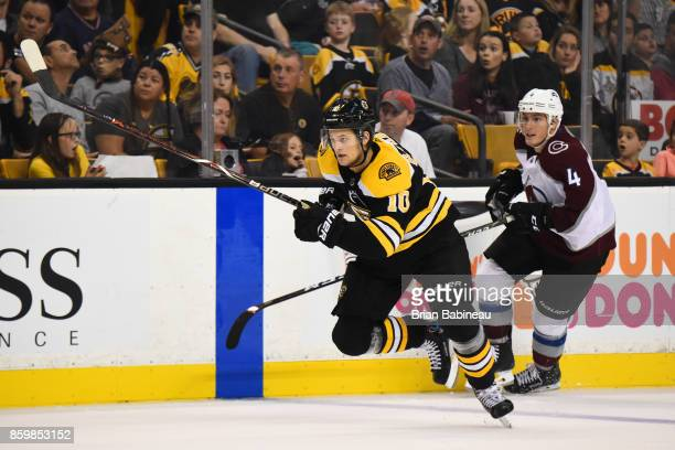 Anders Bjork of the Boston Bruins skates against Tyson Barrie of the Colorado Avalanche at the TD Garden on October 9 2017 in Boston Massachusetts