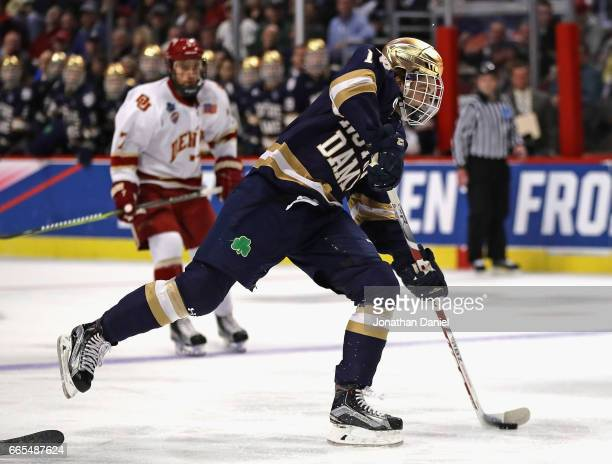 Anders Bjork of the Notre Dame Fighting Irish fires a shot against the Denver Pioneers during game two of the 2017 NCAA Division I Men's Hockey...