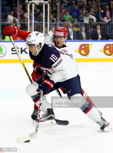 Anders Bjork of USA challenges Matias Lassen of Denmark for the puck during the 2017 IIHF Ice Hockey World Championship game between USA and Denmark...