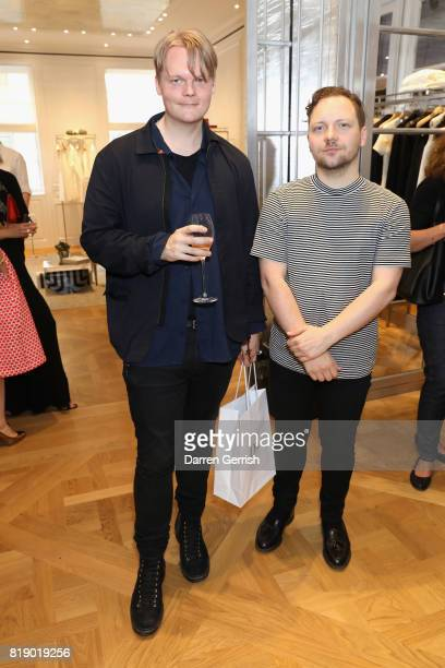 Anders Christian Madsen and Alexander Fury attend the Dior cocktail party to celebrate the launch of Dior Catwalk by Alexander Fury on July 19 2017...