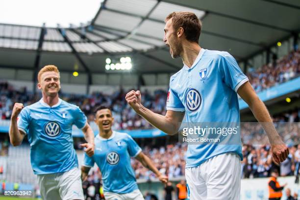 Anders Christiansen and Yoshimir Yotún and Magnus Wolf Eikrem of Malmo FF celebrates after scoring during the Allsvenskan match between Malmo FF and...
