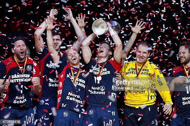 Anders Eggert and Lasse Svan of Flensburg celebrates with the tropy after the DHB Cup Final match between SG FlensburgHandewitt and SC Magdeburg at...