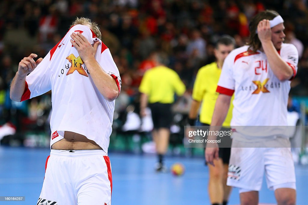 Anders Eggert and Mikkel Hansen of Denmark look dejected during the Men's Handball World Championship 2013 final match between Spain and Denmark at Palau Sant Jordi on January 27, 2013 in Barcelona, Spain.