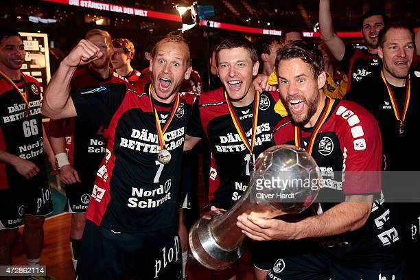 Anders Eggert Lasse Svan and Thomas Mogensen of Flensburg celebrate after winning the DHB Cup Final match between SG FlensburgHandewitt and SC...