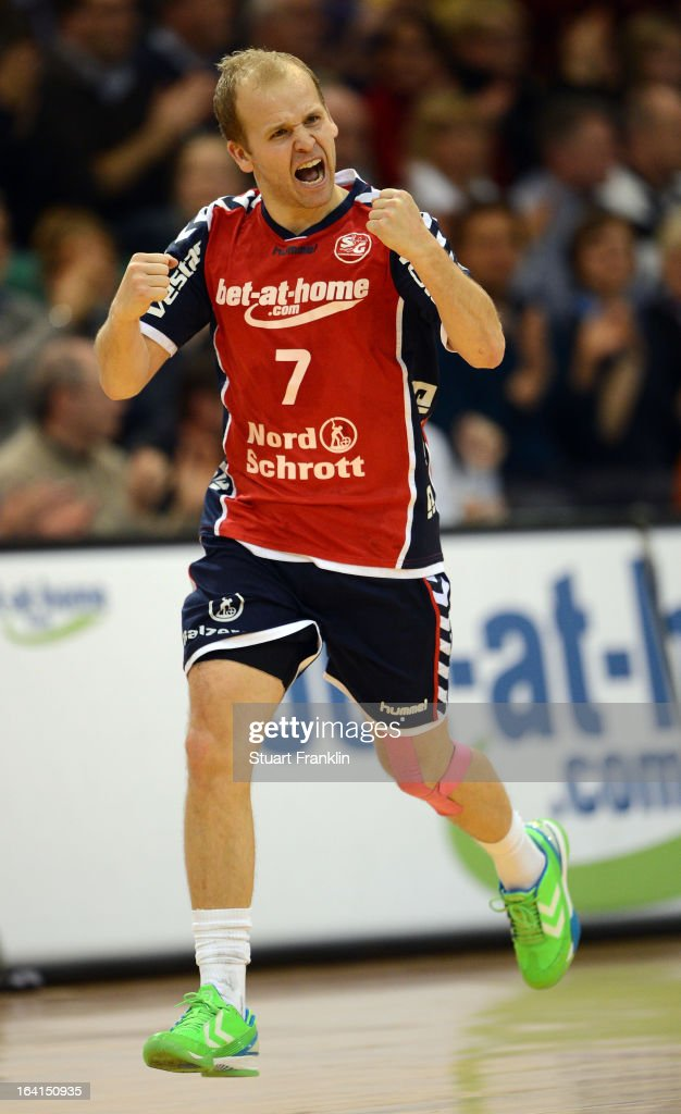 Anders Eggert of Flensburg celebrates during the Toyota Bundesliga handball game between SG Flensburg-Handewitt and Rhein-Neckar Loewen at the Flens arena on March 20, 2013 in Flensburg, Germany.