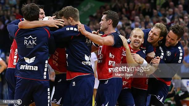 Anders Eggert Steffen Weinhold and Thomas Mogensen of Flensburg celebrate after the DKB Bundesliga handball match between Flensburg Handewitt and HSV...