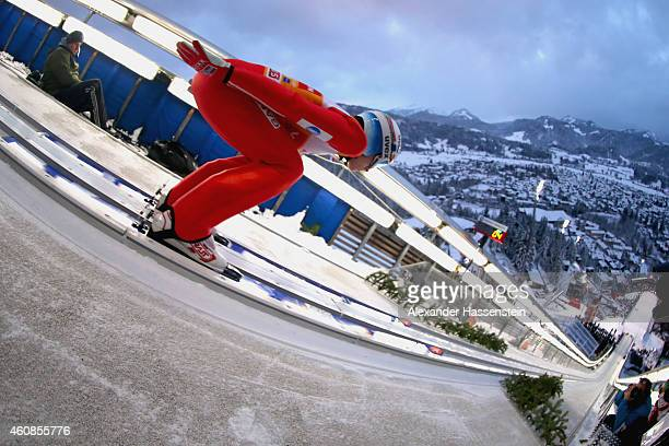 Anders Fannemel of Norway competes on day 1 of the Four Hills Tournament Ski Jumping event at SchattenbergSchanze Erdinger Arena on December 27 2014...