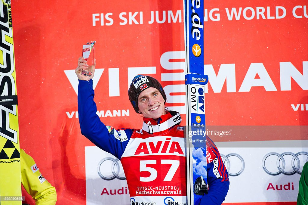 Anders Fannemel raises the trophy at the winners podium after the Large Hill Individual competition on day two of the FIS Ski Jumping World Cup on...
