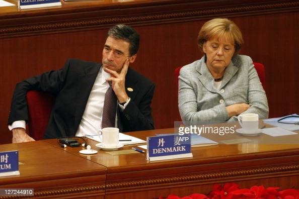 Anders Fogh Rasmussen Prime Minister of Denmark and Angela Merkel Chancellor of Germany attend the opening ceremony of the 7th AsiaEurope Meeting at...