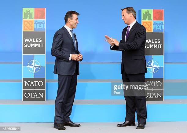 Anders Fogh Rasmussen Secretary General of the North Atlantic Treaty Organization speaks with british British Prime Minister David Cameron during the...