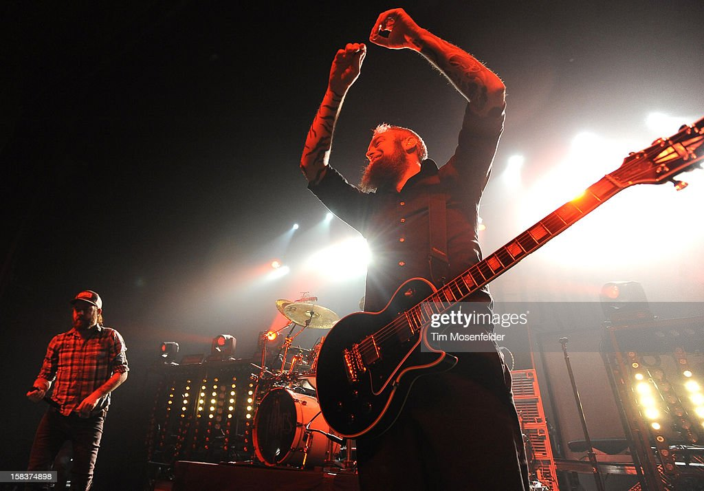 Anders Friden (L) and Bjorn Gelotte of In Flames perform in support of the bands' 'Sounds of a Playground Fading' release at The Warfield on December 13, 2012 in San Francisco, California.
