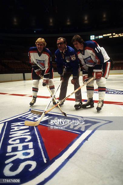 Anders Hedberg head coach Fred Shero and Ulf Nilsson of the New York Rangers pose with their new jersey's in June 1978 at the Madison Square Garden...
