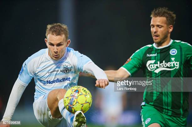 Anders Holst of FC Helsingor and Kenneth Emil Petersen of OB Odense compete for the ball during the Danish Alka Superliga match between FC Helsingor...