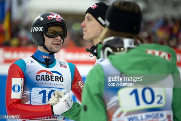 Anders Jacobsen and team mates Andreas Stjernen and Tom Hilde of Norway reacts after placing second in the FIS Ski Jumping World Cup team competition...