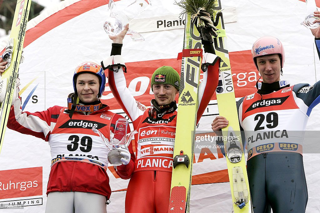 Anders Jacobsen of Norway (2nd), Adam Malysz of Poland (1st) and Martin Koch of Austria (3rd) celebrate on the podium during the FIS Ski Jumping World Cup HS 215 event on March 24, 2007 in Planica, Slovenia.