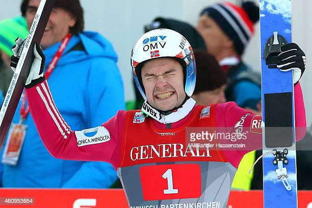 Anders Jacobsen of Norway celebrates winning after his final jump during day 4 of the Four Hills Tournament Ski Jumping event at OlympiaSchanze on...