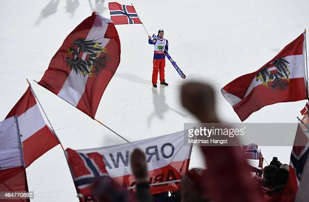 Anders Jacobsen of Norway celebrates winning the gold medal in the Men's Team HS134 Large Hill Ski Jumping during the FIS Nordic World Ski...
