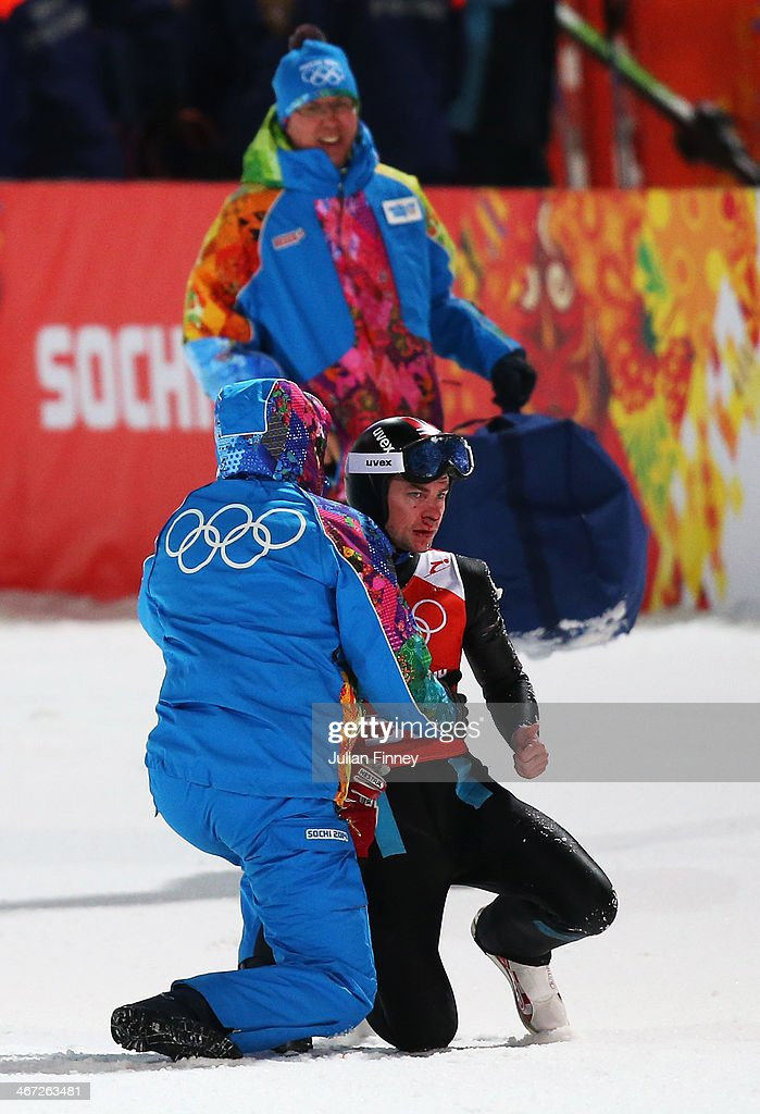 Anders Jacobsen of Norway is given assistance after his jump during the Men's Normal Hill Individual Ski Jumping training ahead of the Sochi 2014 Winter Olympics at the RusSki Gorki Ski Jumping Center on February 6, 2014 in Sochi, Russia.