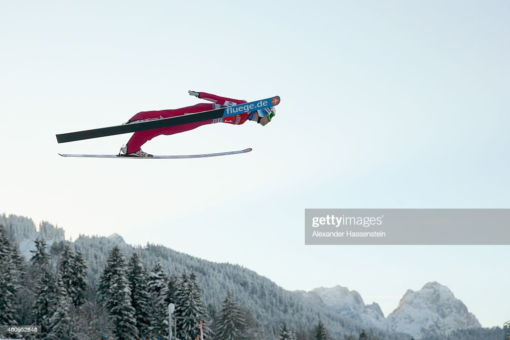 <a gi-track='captionPersonalityLinkClicked' href=/galleries/search?phrase=Anders+Jacobsen+-+Ski+Jumper&family=editorial&specificpeople=12186216 ng-click='$event.stopPropagation()'>Anders Jacobsen</a> of Norway soars over Germany's highest mountain Zugspitze (L) with 2.962 metres and Waxenstein (R) during day 4 of the Four Hills Tournament Ski Jumping event at Olympia-Schanze on January 1, 2015 in Garmisch-Partenkirchen, Germany.