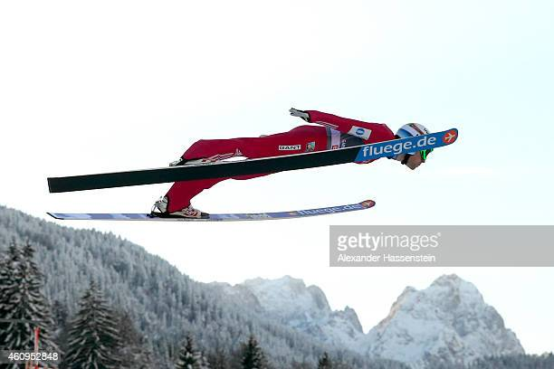 Anders Jacobsen of Norway soars over Germany's highest mountain Zugspitze with 2962 metres and Waxenstein during day 4 of the Four Hills Tournament...