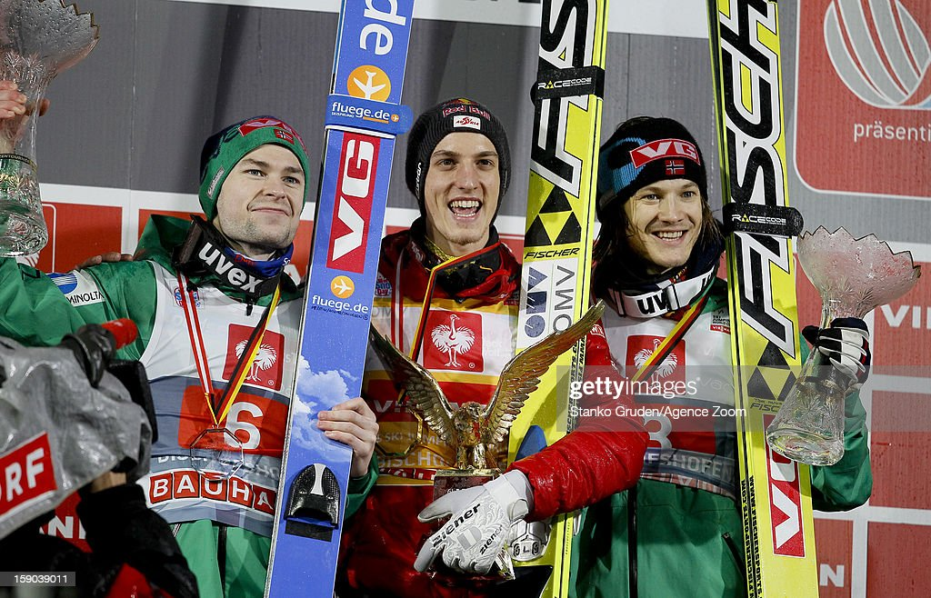 Anders Jacobsen of Norway taks 2nd place, Gregor Schlierenzauer of Austria takes 1st place, Tom Hilde of Norway takes 3rd place during the FIS Ski Jumping World Cup Vierschanzentournee (Four Hills Tournament) on January 06, 2013 in Bischofshofen, Austria.