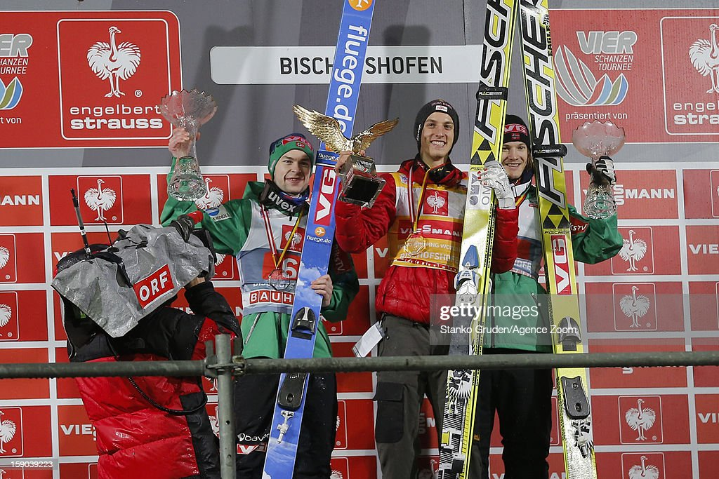 Anders Jacobsen of Norway taks 2nd place, Gregor Schlierenzauer of Austria takes 1st place, Tom Hilde of Norway takes 3rd place during the FIS Ski Jumping World Cup Vierschanzentournee (Four Hills Tournament) on January 06, 2013 in Bischofshofen, Austria.