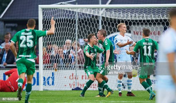Anders K Jacobsen and Mathias Greve of OB Odense celebrates after scoring their first goal during the Danish Alka Superliga match between FC...