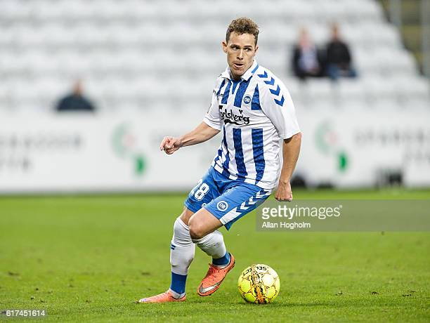 Anders K Jacobsen of OB controls the ball during the Danish Alka Superliga match between OB Odense and FC Copenhagen at EWII Park on October 23 2016...
