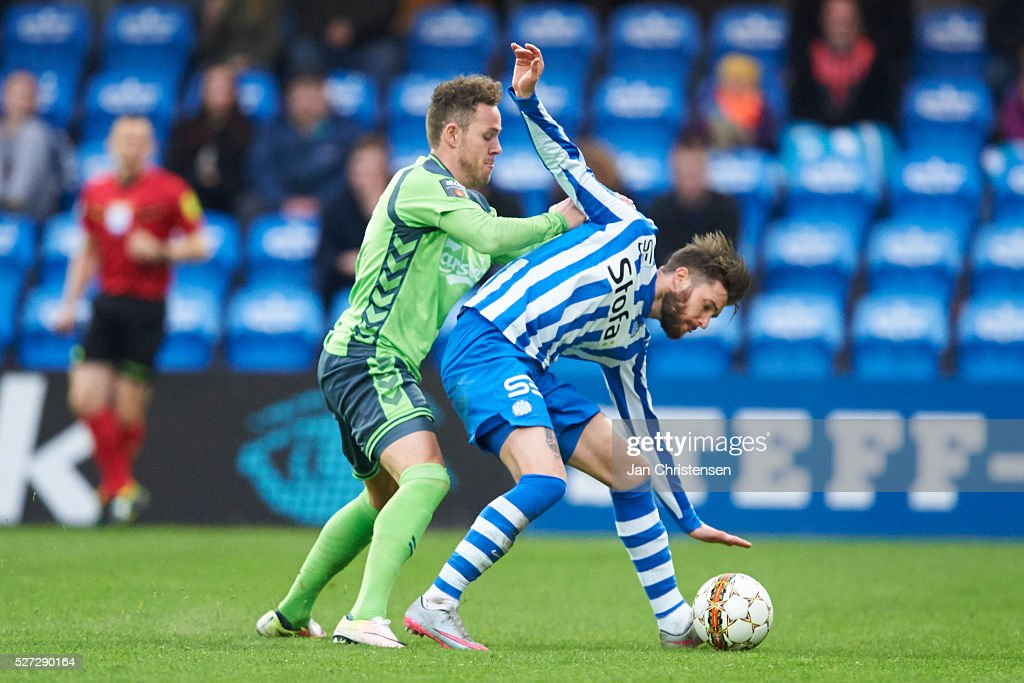 Anders K. Jacobsen of OB Odense and Daniel Stenderup of Esbjerg fB compete for the ball during the Danish Alka Superliga match between Esbjerg fB and OB Odense at Blue Water Arena on May 02, 2016 in Esbjerg, Denmark.