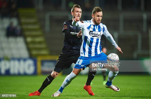 Anders K Jacobsen of OB Odense and Mads Fenger of Randers FC compete for the ball during the Danish Alka Superliga match between OB Odense and...