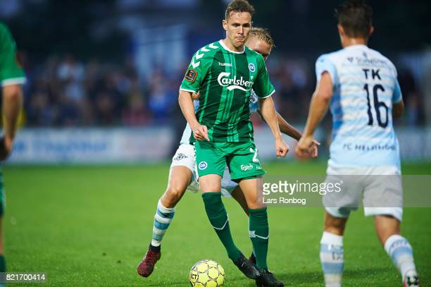 Anders K Jacobsen of OB Odense controls the ball during the Danish Alka Superliga match between FC Helsingor and OB Odense at Helsingor Stadion on...